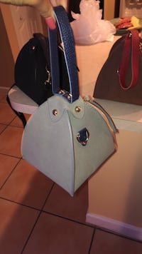 gray and black leather tote bag Doral, 33126