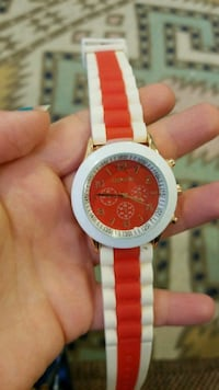 round silver and red chronograph watch with red strap