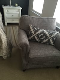 Gray and white floral sofa chair Raleigh, 27617