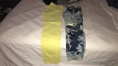 two yellow and blue denim pants