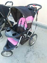 baby's black and pink jogging stroller