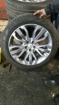 chrome multi-spoke car wheel with tire Bradford, BD7 2BZ