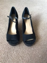 pair of black open-toe mary jane heeled shoes