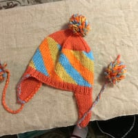 knitted orange, blue, and yellow cap