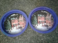 two blue framed multicolored decorative plates