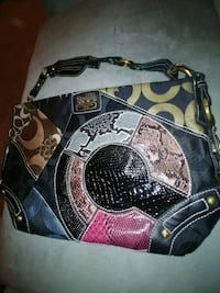 A beautiful, large, zippered, black Coach handbag. Myrtle Beach, 29575