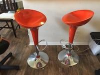 Orange-red modern bar stools.                i am at my garage today for a couple hours in calabasas - but leaving town tomorrow for three weeks. if you're interested please contact asap.  i see somebody favor today but i don't know how to directly connec Calabasas
