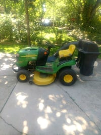 John Deere riding tractor with bagger