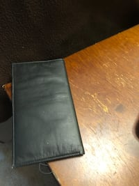 Men's black leather wallet never used brand new asking $20 see pictures if posted it's available  3738 km