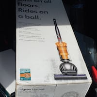 red and black Bissell upright vacuum cleaner box Bakersfield