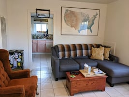 Gray couch with lounge and side table