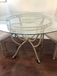 Glass Kitchen table with 4 chairs.