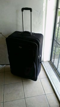 black soft-side luggage 1203 mi