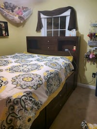 LIKE NEW....Queen size platform storage bed Sterling
