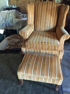 brown, beige, white, and green fabric wing chair with ottoman