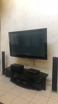 Panasonic TV 65' with a table, and suspends system by Energy Henderson, 89074