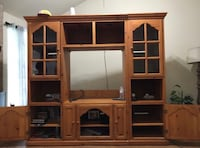 brown wooden TV hutch with flat screen television Spring, 77379