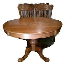Dining table with 4 chairs and matching Hutch