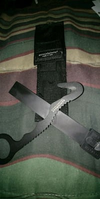 black Benchwade tool with black sheath Winnipeg, R3C 1Z1