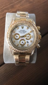 Round gold rolex chronograph watch with silver link bracelet Maple Ridge, V2X 7H5