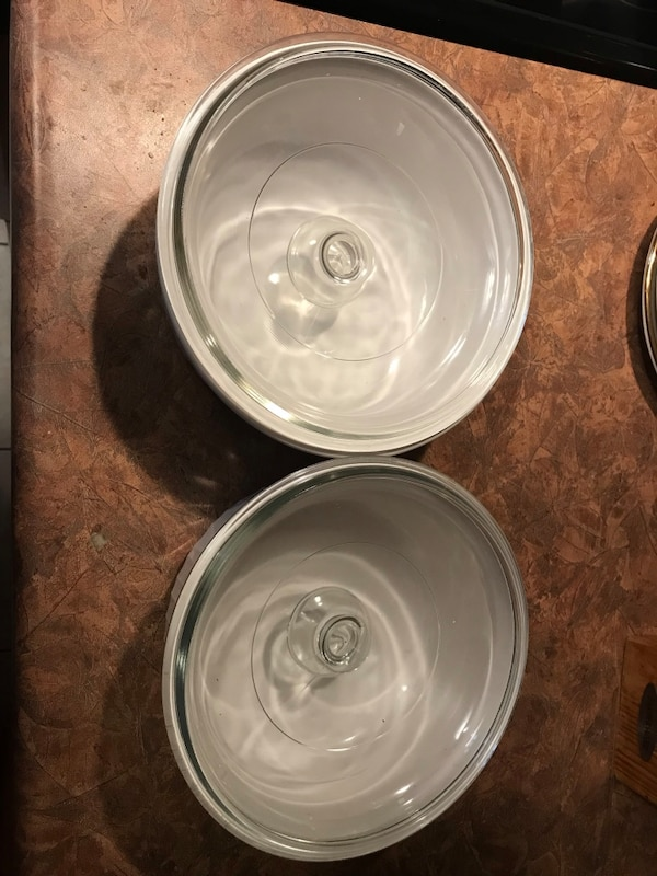 Two  round white Corningware with lid never used