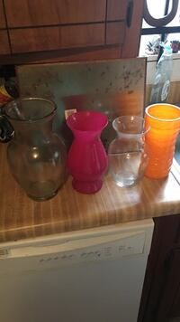 several clear, pink, and yellow flower vases Houston, 77008