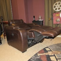 brown wooden framed brown leather padded sofa