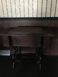 brown and black sewing machine table