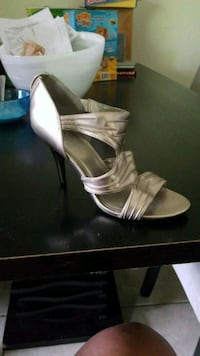 pair of gold open-toe ankle strap heels Lake Worth, 33461