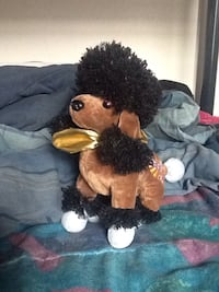 Brown and black poodle dog plush toy