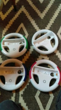 four white driving Wii steering wheels Knoxville, 37919