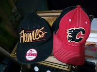 two black and red fitted caps Welland, L3B 5N5