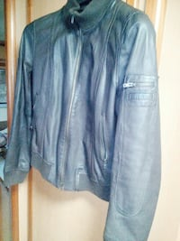 giacca con zip in pelle nera