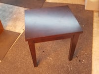 Small square tables in dark wood Los Angeles