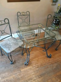Glass top rod iron table and chairs  Mississauga, L5E