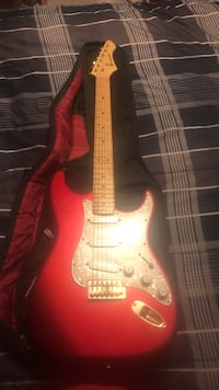 Red and white stratocaster electric guitar Calgary, T3J 3E9