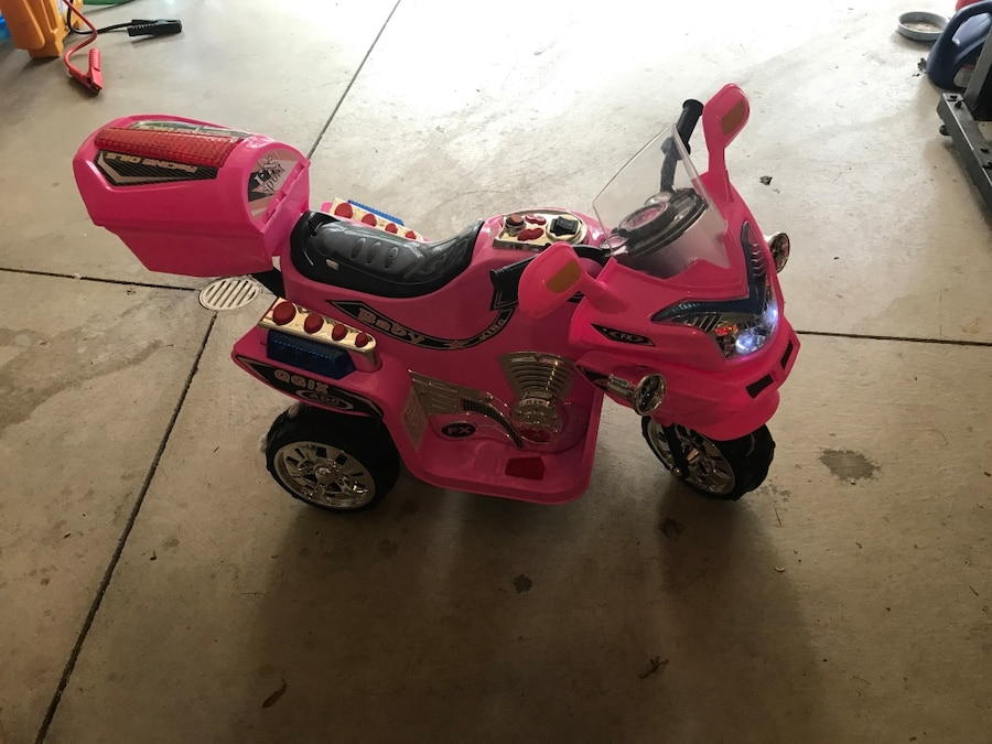 pink and black trike ride-on