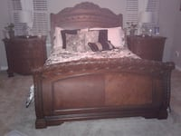 brown wooden bed frame with mattress null