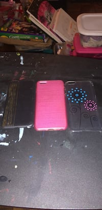 three assorted-color iPhone cases 28 mi