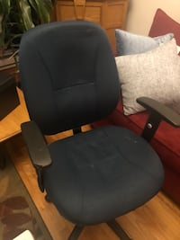 Navy blue swiveling office chair