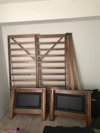 two brown wooden bed frames Fort Myers, 33912