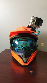 Orange and black full-face motorcycle helmet Kelowna, V1X 2B4