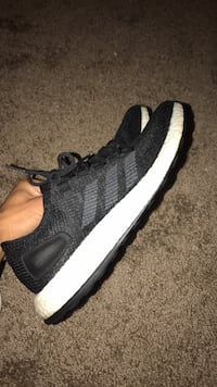 Unpaired black and white adidas running shoe Oxnard