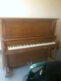 brown wooden piano, 103 years old, works great  El Paso, 79912