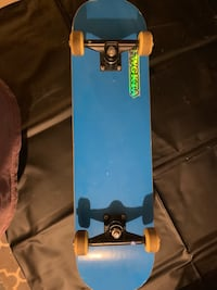 Skateboard with Holographic Odd Future Sticker