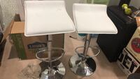 two stainless steel base white leather padded bar stools 42 km