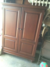 Brown wooden TV armoire
