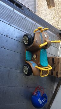 toddler's brown ride-on toy