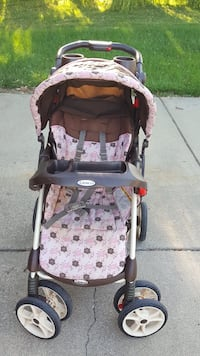 baby's pink and black stroller West Lafayette, 47906