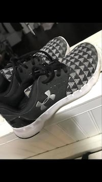 pair of black-and-white Nike running shoes Montréal, H8N 2S2